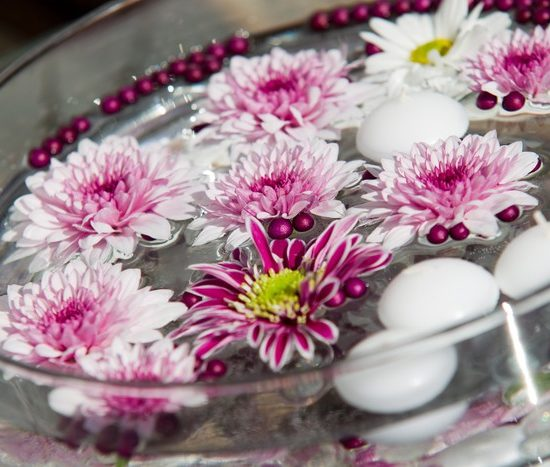 Floating Candles and Flowers. Decoration for a garden party