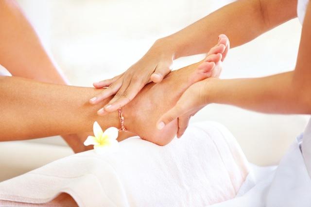 Closeup of feet receiving a massage